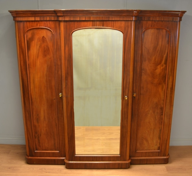 Quality Victorian Mahogany Break-fronted Triple Wardrobe with Amber Glass Handles
