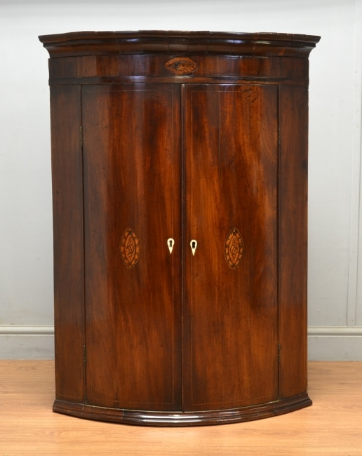 Georgian Bow Fronted Mahogany Antique Corner Cupboard with Shell Inlay.