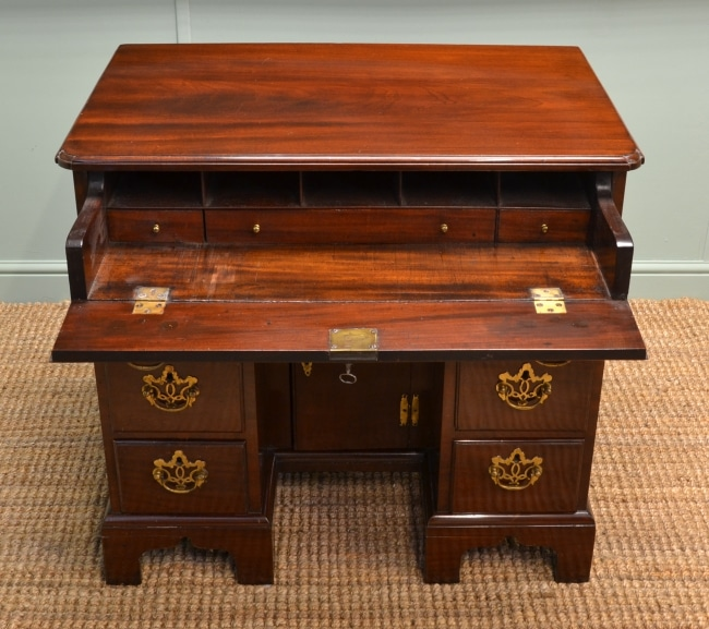 https://antiquesworld.co.uk/antique-furniture/flamed-mahogany-antique-secretaire-chest-in-the-biedermeier-style/