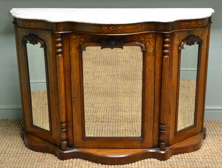 https://antiquesworld.co.uk/antique-furniture/magnificent-quality-ebonised-satinwood-inlaid-antique-credenza/