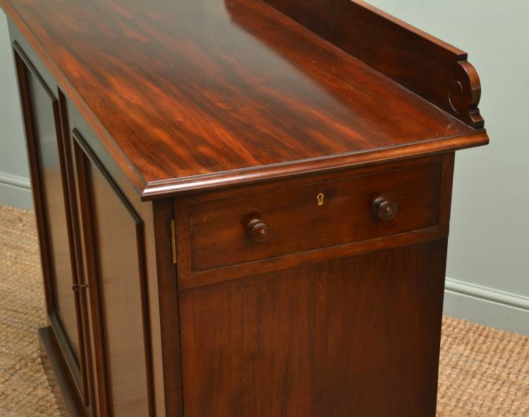 Side server drawer with turned handles and hardwood lining