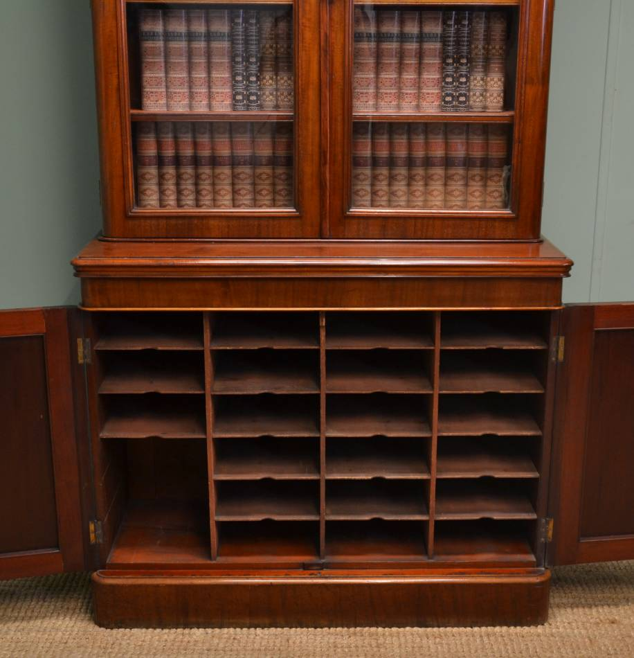 """Victorian Mahogany Glazed Antique Bookcase Above Fitted Cupboard with the original makers label of """"S & H Jewell, Little Queen St. Holborn""""."""