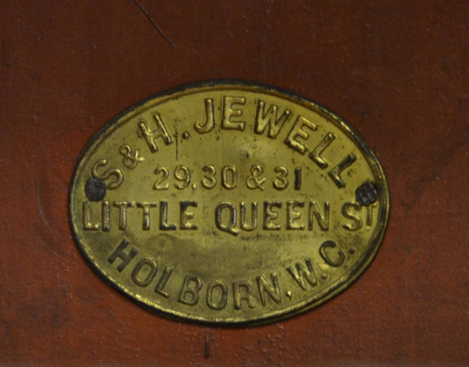 "Victorian Mahogany Glazed Antique Bookcase Above Fitted Cupboard with the original makers label of ""S & H Jewell, Little Queen St. Holborn""."