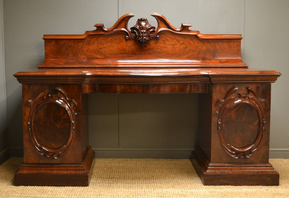Pedestal Sideboard with 'Green Man' decoration.