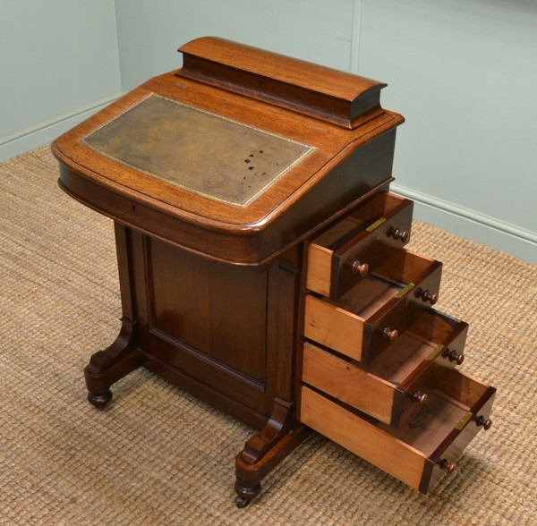 This quality Victorian oak antique Davenport / antique writing desk dates  from ca. 1870 and has a shaped, curved lid and the interior has letter  racks, ... - Antique Davenport Desk - Antiques World