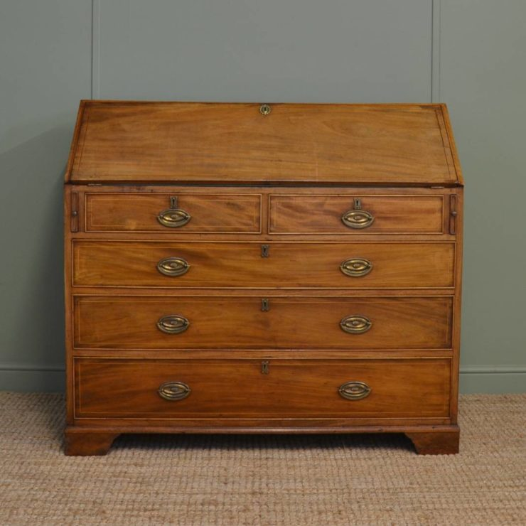 Georgian, Mellow Mahogany, Antique Bureau with Birds Eye Maple Interior. This antique mahogany bureau dates from around 1800 in the Georgian period and has an unusual fitted interior