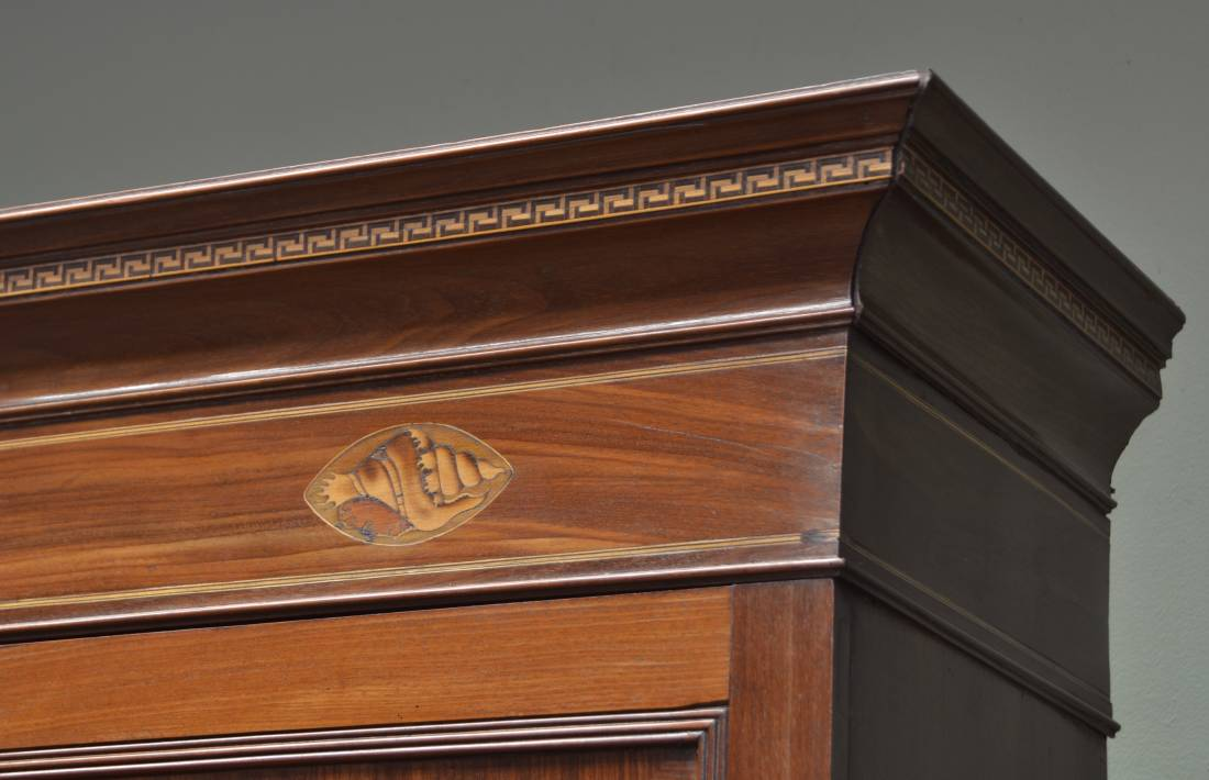 Inlaid shell on Antique Cupboard
