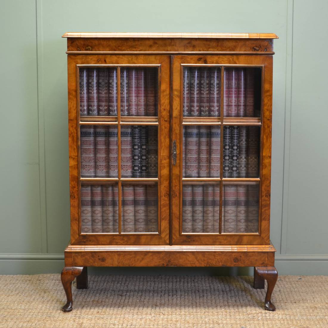 Golden Burr Walnut Edwardian Glazed bookcase on Cabriole Legs