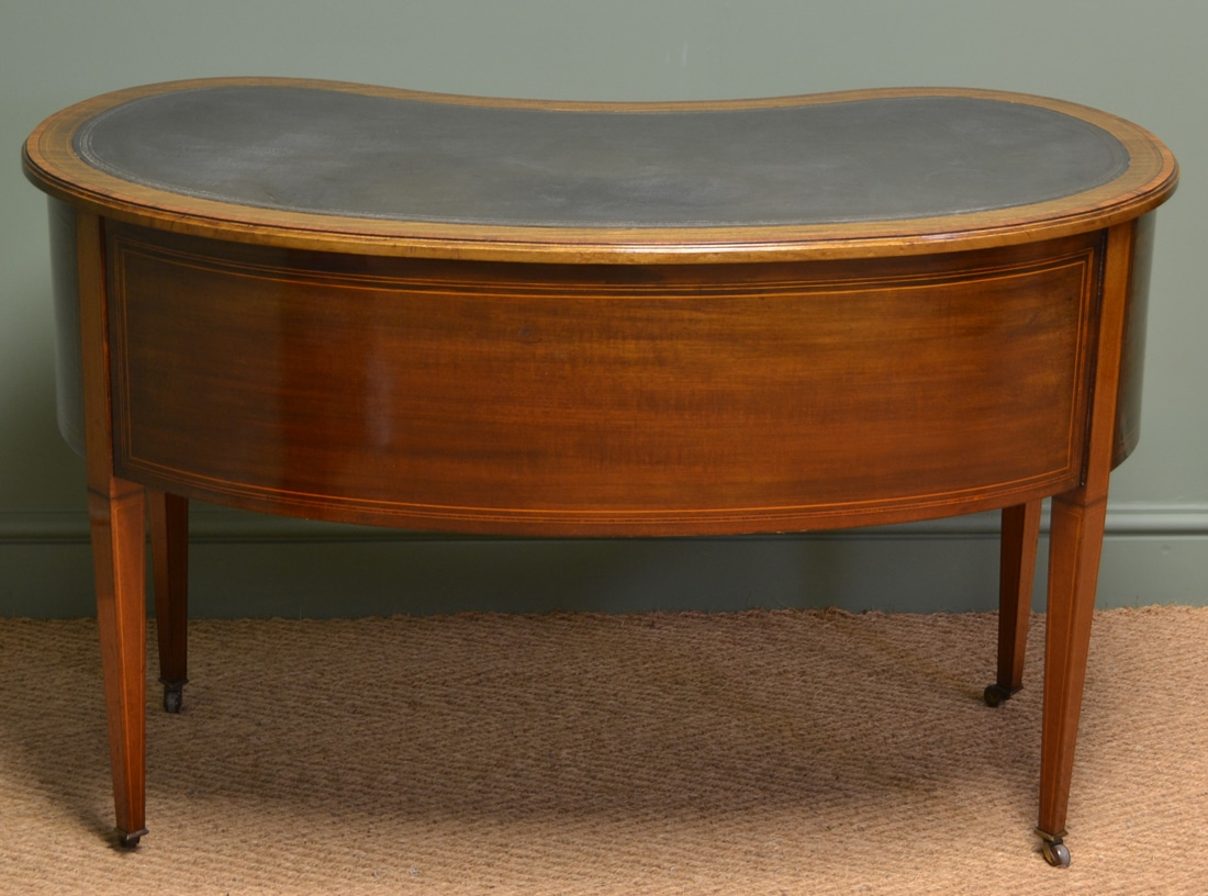 kidney shaped writing desk Made in crawfordsville, indiana by the umphrey manufacturing company created during the 1920s gorgeous mahogany finish with decorative filials.