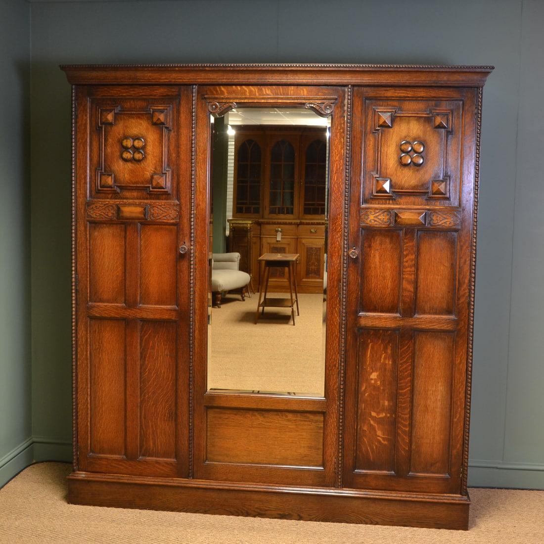 Waring and Gillows Edwardian Oak Antique Triple Wardrobe