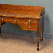 This Stunning Figured Victorian Mahogany Antique Writing Table, circa, 1890 has a shaped raised up-stand above a beautifully figured bow fronted top with two long over two short oak lined drawers with satinwood crossbanded edge and the original decorative brass handles.