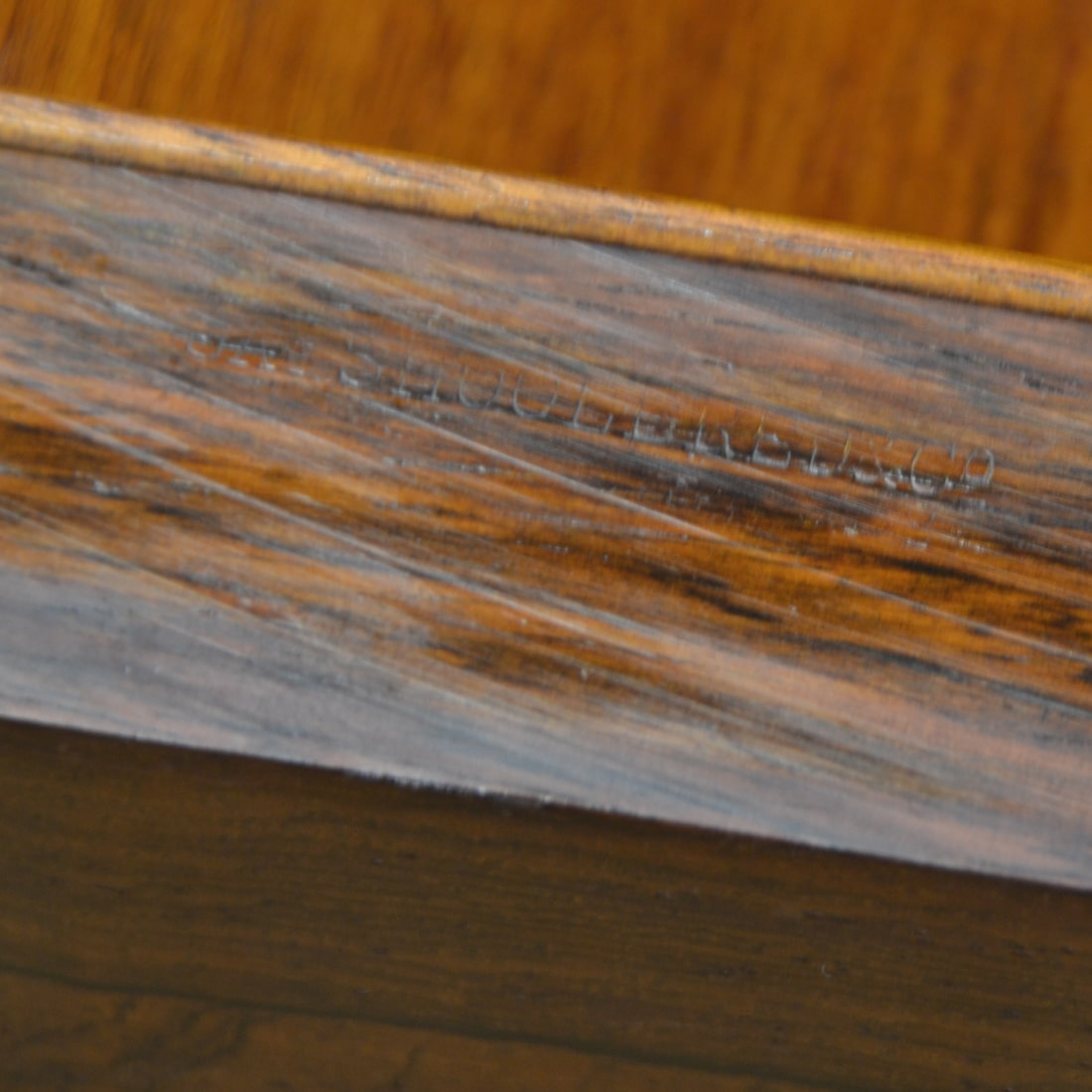 embossed stamp on the edge of the games table