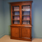 Striking Glazed Figured Mahogany Antique Victorian Bookcase on Cupboard