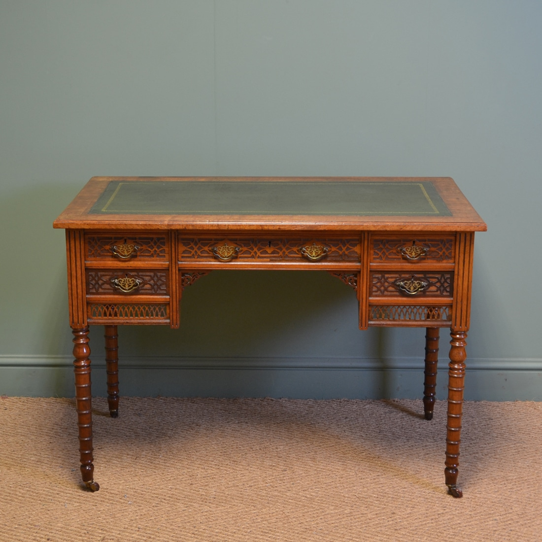 Writing Desk by JAS Shoolbred with decorative blind fretwork carvings