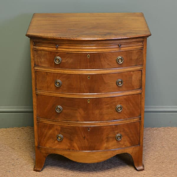 Small Edwardian Bow Fronted Mellow Mahogany Antique Chest of Drawers with Brushing Slide