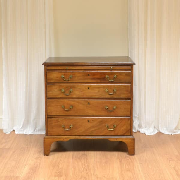 Small George III Quality Antique Chest Of Drawers with Brushing Slide