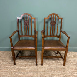 Unusual Pair of Edwardian Oak Carver Chairs by JAS. Shoolbred